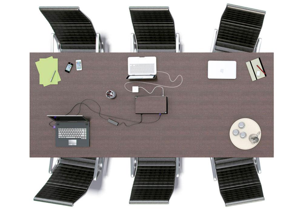 Boîtier de prises escamotable intégré au centre d'une table